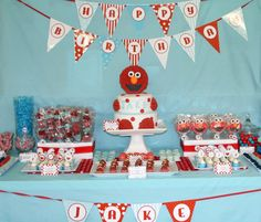 May use this idea with my Toy Story banner, gonna use a cake platform made from boxed wrapped in Toy Story wrapping paper. I like the treats on display in front of the cake platform.