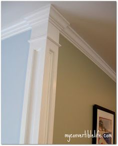 Add trim to corners of a wall to separate colors and produce a beautiful column effect.