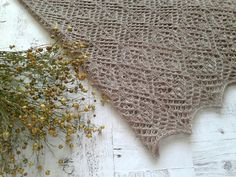Hand knitted lace shawl in cappuccino color. Merino wool