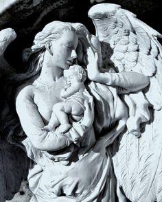 Angel holding my baby