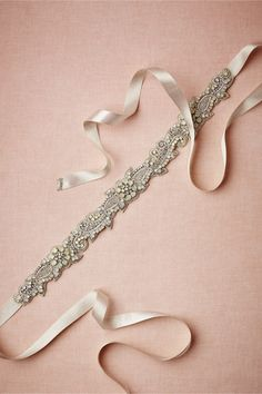 Expensive, but if my dress is under $1000, probably worth it. And I might actually wear a sparkly belt again after the wedding. / Pearly Primrose Sash from BHLDN