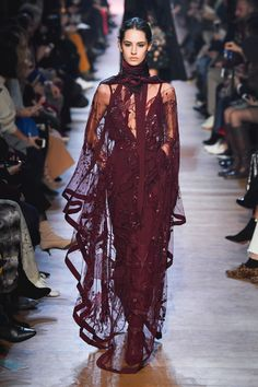 Elie Saab Fall 2018 RTW: Gorgeous wine colored embellished dress with sheer dramatic sleeves