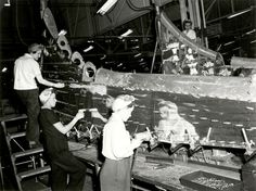 Female riveters are shown assembling the tail fin of a B-17 Flying Fortress at The Boeing Company's Plant 2 in this 1943 publicity photo from the Boeing Company. (Photo by Reuters/Boeing)