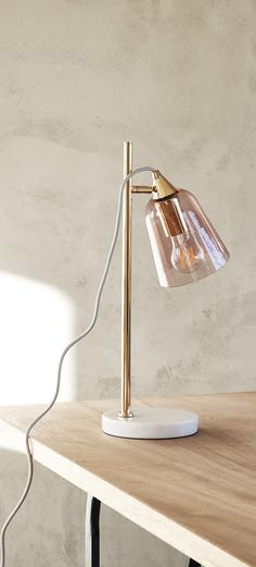 Light up your living space with the rose-tinted shade of the Glass Shade Marble Table Lamp.