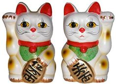 """The Maneki-neko (招き猫, literally """"Beckoning Cat""""; also known as Welcoming Cat, Lucky Cat, Money Cat, or Fortune Cat) is a common Japanese figurine (lucky charm, talisman), usually made of ceramic, which is believed to bring good luck to the owner."""