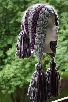 Free Pattern - Capucine hat. I would do long braided tassels in the front instead of the fringe tassels. <3