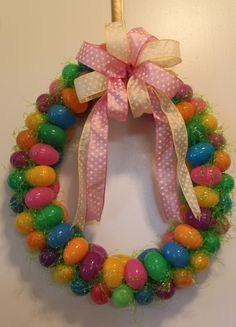 My first Easter Egg Wreath.   1. Pipe insulation cut in half and duct taped together.  2. Glue eggs inside of ring.  3. Glue grass on outside to cover insulation.  4. Glue on eggs on top and side.  5. Fill holes with grass. Trim grass.  6. Add bow and hang.
