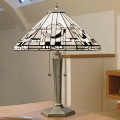 Metropolitan Medium Nickel Table Lamp Art deco in a contemporary setting with the Metropolitan Medium Nickel Table Lamp. H: 380 W: 250 D: 250 Bulbs: 1 x 40 E14 Fittings: DBN133M Shade: TM25M