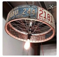 Gooseneck lamp updated bicycle gear and chain recreated into a badass lamp shade for the speakeasy we could wrap it with our ca license plates up cycled lighting inspiration for a bicycle wheel diy garage solutioingenieria Images