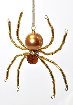 CHRISTMAS SPIDER: Beaded Ornament in Shades of Gold with Glass Pearl Body. $11.50, via Etsy.