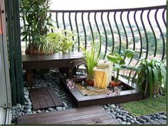 Pretty up your balcony by adding plants and grass. You can easily grow out a small amount of grass framed with pebbles and wooden planks as your walkway. You can design your very own landscape with help from some custom built furniture.
