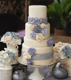 <3 cake with flowers and decor around it