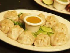 Nepali Momo (Nepalese Meat Dumplings) from Food.com: This stuffed dumpling preparation is one of the most popular dishes in Nepal. This dish is an example of Tibetan influence in Nepali cuisine.