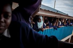 Photographer Jake Naughton documents the struggle to provide girls an education in Kibera