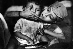 Gordan Parks Photography :  Flavio – Flavio da Silva feeding his brother, Zacarias. Rio de Janeiro, 1961