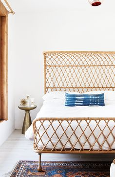 vintage modern boho master bedroom with african indigo lumbar pillow, design by @sarahshermansamuel #vintagerugshopinthewild