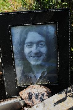 the picture of Rory at his grave in St Olivers cemetery near Ballincollig Ireland you can better see the rock I carved, it was a rock I'd brought home from Ireland the first time I went