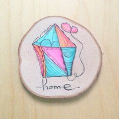 "Love this little original painting on a wood slice from artist Kelly Barton. Would be the perfect gift for someone who needs to take a reminder of ""home"" with them."