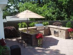 Create an outdoor area the whole family can enjoy with a fully-functional outdoor kitchen by Cambridge Pavers.