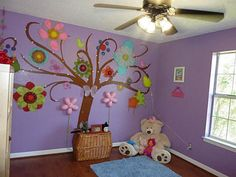 Great tree mural for baby girl's room.