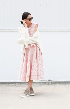 We love how Fiona paired this dreamy pink ensemble with Daniela high-top sneakers by Joie for a modern twist! Photo: fifideluxe.com