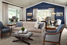 blue-white-living  Too big as example. What works; warmer color on ceiling, though NOT this color/more of a buttery cream....like easy mixing of tan and white Fun pillows but too stuffy.