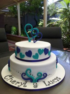 purple and turquoise - Engagement cake with purple and turquoise accents