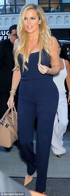 'This booty takes work!' Khloe Kardashian shares fitness tips at gym #dailymail