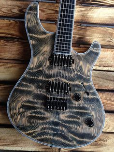 """Mayones Regius 6 Custom Shop, Hand-selected Douglas Fir top, Trans Jeans Black Matte finish, Black Limba (Korina) body wings, 11-ply neck-thru-body section (Hard Rock Maple, Mahogany, Wenge, Amazakoe), Trans Natural Matte back finish, Ebony fingerboard, 16"""" Radius, 24 Ferd Wagner medium jumbo frets, 25.4"""" scale, side dot markers only, 3-ply Gray ABS / White acrylic binding, Bare Knuckle Pickups Painkiller calibrated set with Battleworn covers,"""