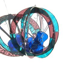 In Tune Medium Stained Glass 3D Sphere Music by katiediditglass. $68.00, via Etsy.