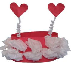 inspiration... cut heart shapes in crown and poof out tissue paper in the shape of the heart (instead of the 'paper flower') also adhere big paper heart to center done in same way for added dimension.