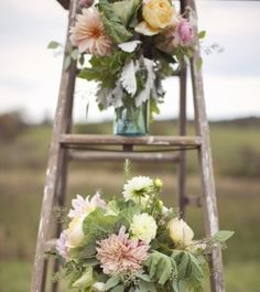 Great simple idea for a wedding decoration. An old wooden ladder with jars uses to hold flowers