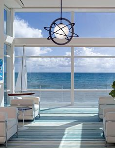 Stunning ocean view, which is perfectly complimented by a classic blue-and white interior, but done in a more modern and clean-lined way (by American Lighting Association)