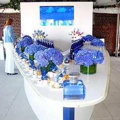A white, boat-shaped counter decorated with blue hydrangea, blue bottles of water and blue drinking glasses was the decorative centerpiece at the Ralph Lauren Blue fragrance launch at the penthouse at the Hudson Hotel.