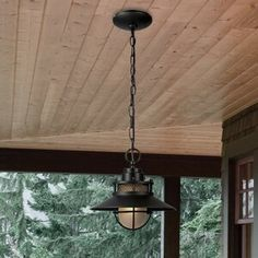 Suited for illuminating the front porch or casting a warm glow over alfresco dinners on a covered patio, this pendant is the perfect pick. Designed to live in damp environments, like those outdoors, i Outdoor Barn Lighting, Outdoor Hanging Lanterns, Outdoor Chandelier, Outdoor Ceiling Fans, Outdoor Walls, Dining Lighting, Porch Lighting, Rustic Outdoor, Rustic Lighting