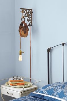 How to Use a Barn Pulley to Make a Wall-Mount Light Fixture Create a unique sconce—based on a commercial industrial-look fixture—for a fraction of the cost Wall Mount Light Fixture, Farmhouse Light Fixtures, Industrial Light Fixtures, Wall Mounted Light, Kitchen Lighting Fixtures, Outdoor Light Fixtures, Farmhouse Lighting, Industrial Lighting, Industrial House