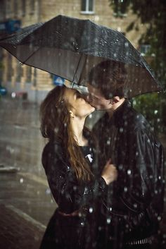 Kissing in the rain love cute kiss rain outdoors couple
