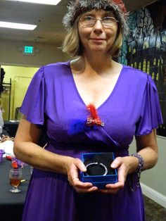 Raffle Prize winner. Beautiful Joan Boyce kissing bracelet in hematite and purple crystals