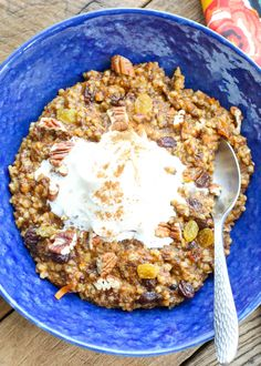 Carrot Cake Oatmeal topped with whipped cream is a breakfast treat! get the recipe at barefeetinthekitchen.com