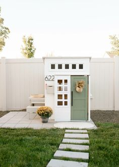 modern diy painted playhouse - play house makeover with platform and backyard area / modern boho farmhouse fall feel