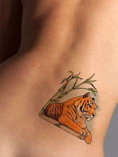 This colorful tiger watercolor tattoo looks great on as a shoulder tattoo, chest tattoo, leg or arm tattoo, or anywhere you choose to wear it! This regal tiger tattoo symbolizes nobility, protection a