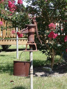 rusty garden pump-put on a pole to elevate Garden Junk, Flowers, Rusty Garden, Country Gardening, Outdoor Gardens, Old Water Pumps, Yard Decor, Rustic Gardens, Garden Projects