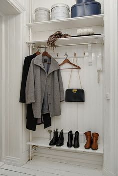 Open wardrobe in the hallway niche - use dead space -- all white creates  clean uncluttered look
