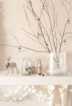 twigs with small ornaments in vase