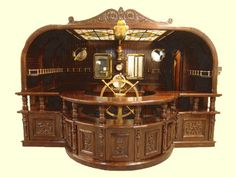 simplytheanthropic:    Atlanta-based antique dealer's bar collection, Red Baron    Oh want.  Oh future King of Canada…might we have this bar in our under-library-lair? And might we retrofit our library to detach itself and act like a ship? Because we might need a ship. For librarian crimefighting on the seas purposes and stuff.