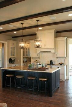 Love Everything About This Kitchen The White Cabinets Black Island Light Fixtures Ceiling Beams And Countertops