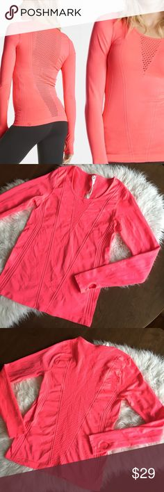 """Fabletics Arta Seamless Vented Long Sleeve Hot pink long sleeve stretch top with thumb holes. Gently worn. 💫 Smoke free home. Offers are welcome though the """"offer"""" button. No negotiations in the comments. No trades/holds/modeling requests, please. 1 day average ship time. Bundle multiple items for a discount and only pay for shipping once! Fabletics Tops"""