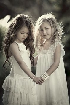 I think If we had two girls that's what they would look like! Completely different. One like me, the other like daddy :D