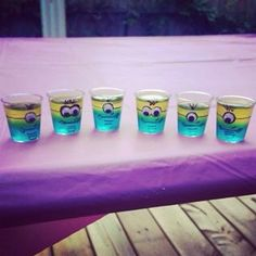 Minion Jello Shots! Creative way to spice up your typical party shots and they are adorable to boot! Despicable Me finds another way into the hearts of many, this time focusing a little more of that hidden adult humour if you know what I mean... All you need is to make blue jello substituting some of the water for alcohol, let it set. Make yellow jello and pour it on top of the set blue jello and let that set. You can decorate the cups before or after the jello is in them but I recommend…