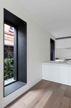 Black framing, white walls, big floor boards/wood . . . Beaconsfield Pde House | Clare Cousins Architects